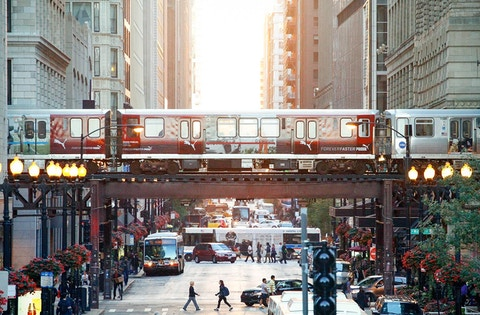 Chicago CTA train passes over busy street traffic