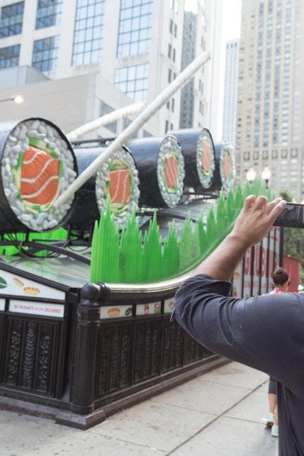 Man photographs GrubHub sushi ad campaign on top of Chicago CTA subway entrance