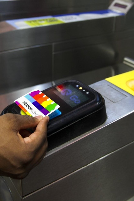 Person scans vitaminwater card to enter Chicago station