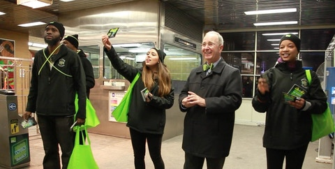 Representatives pass out H&R Block flyers in Chicago CTA station