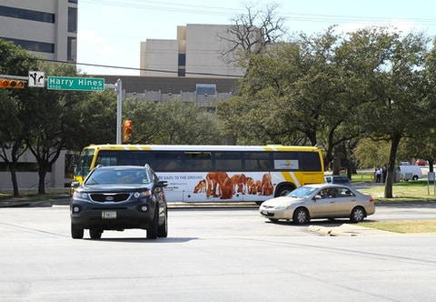 DART bus in Dallas with Dallas Morning News campaign