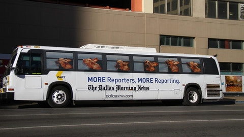Full view of DART bus with Dallas Morning News ad campaign