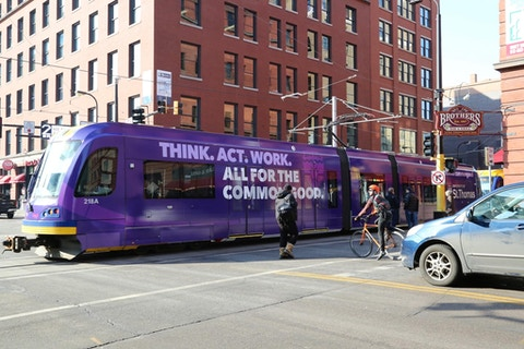 University of St. Thomas Metro Transit bus wrap in Minneapolis