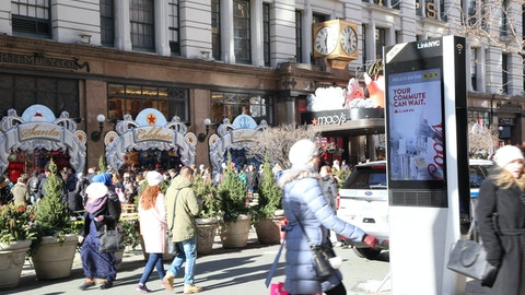 Holiday shoppers view Link in Herald Square in New York