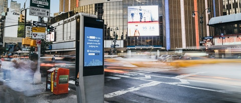 Traffic in front of Madison Square Garden with Link kiosk