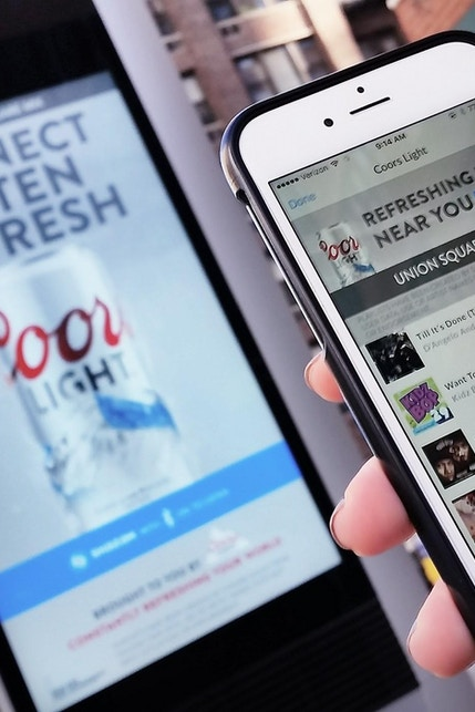 Link wi-fi used to download playlist on phone during MillerCoors Shazam campaign in NYC
