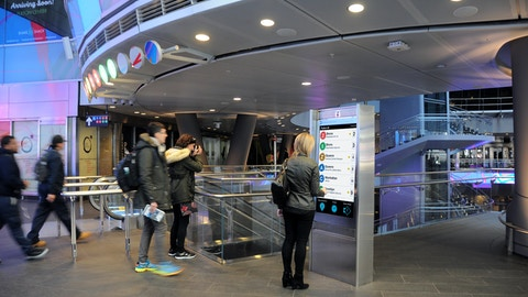 Commuters at Fulton St Station use Intersection's Interactive Information Kiosk in New York