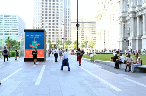 People walking and relaxing in Philadelphia's Dilworth plaza
