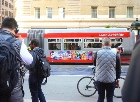 San Francisco bus and commuters with Summer of Love media