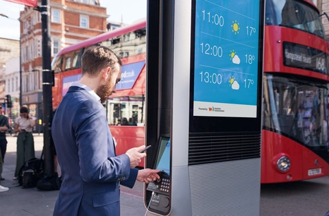 Man uses tablet on InLink in London