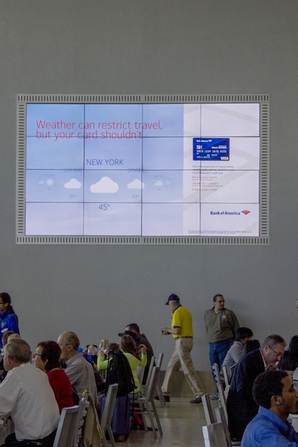 Digital display with BankAmericard advertisement at CLT airport in Charlotte