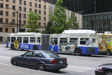 Seattle Sound bus displaying Bellevue Rare Coins full wrap