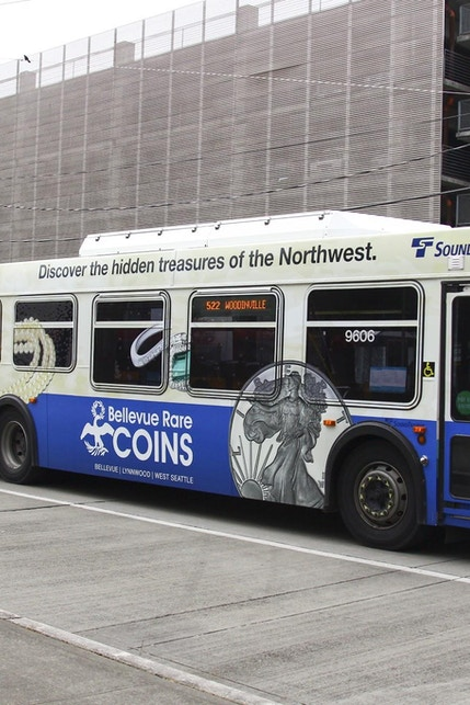 Seattle Sound Transit bus displaying Bellevue Rare Coins full wrap