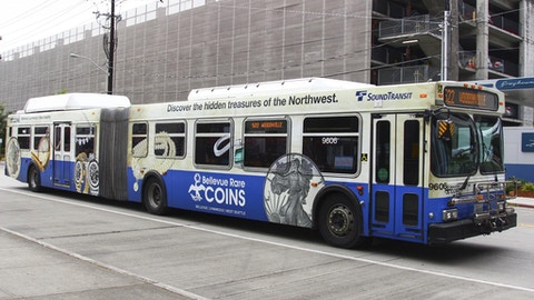 Seattle Sound Transit bus displaying Bellevue Rare Coins full wrap