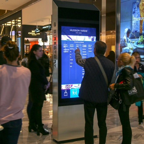 People interacting with kiosk in Hudson Yards