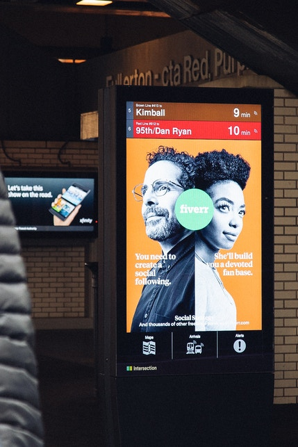 IxNTouch kiosk with transit times and advertising in the Chicago Transit Authority