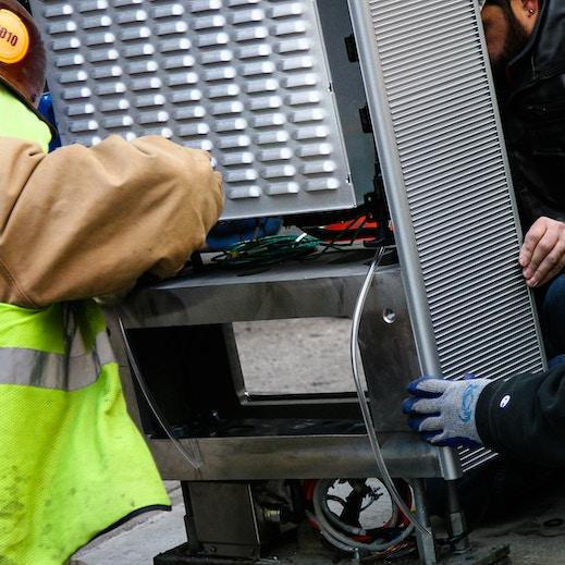 Operations team installs kiosk