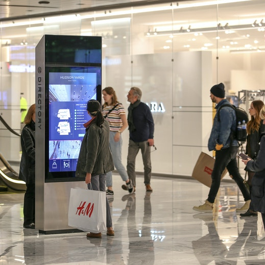 Shopper browses Hudson Yards IxNTouch kiosk