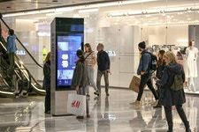 Shopper browses Hudson Yards IxNTouch kiosk