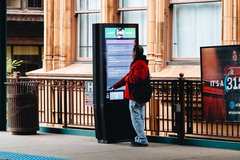 User browses transit information in Chicago on IxNTouch kiosk