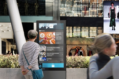 Visitor views events on IxNTouch kiosk
