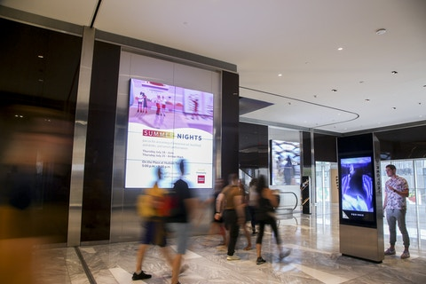 Visitor interacts with IxNTouch kiosk in Hudson Yards