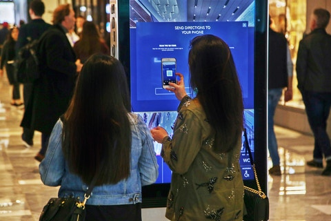 Shoppers send directions to their phones using IxNTouch kiosks